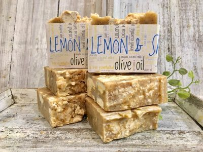 A blend of lemon, ylang ylang & litsea essential oils, oils, double butters for cleansing, moisturizing with ground sage for exfoliation by Lion's Market by Ann