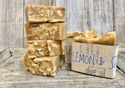 A blend of lemon, ylang ylang & litsea essential oils, oils, double butters for cleansing, moisturizing with ground sage for exfoliation by Lion's Market by Ann.