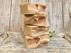Pomegranate fruit goat's milk soap. Creamy, silky & high lather. Pomegranate is an antioxidant-rich fruit for skin relief. Using on a regular basis fights acne and other skin problems by Lion's Market by Ann.