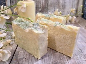 Lucious fresh lemons are blended with shea butter, organic milks, essential oils and sea salts for a lathering, skin-nourishing exfoliating salt bar by Lions Market by Ann